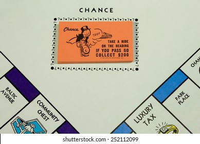RIVER FALLS,WISCONSIN-FEBRUARY 12,2015: Closeup view of a Monopoly board showing the Chance cards. Monopoly originated in the United States in Nineteen Hundred Three.