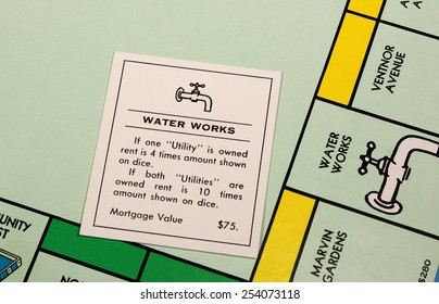 RIVER FALLS,WISCONSIN-FEBRUARY 18,2015: A closeup view of a Monopoly board featuring the Water Works card.