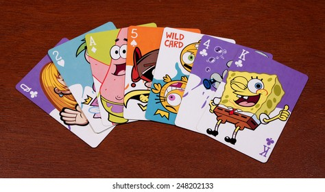 RIVER FALLS,WISCONSIN-JANUARY 29,2015: A collection of seven SpongeBob SquarePants playing cards. The SpongeBob tv series debuted in Nineteen Ninety Nine.