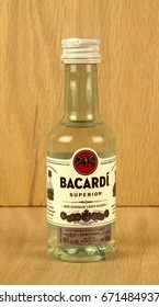 RIVER FALLS,WISCONSIN-JULY 04,2017: A bottle of Bacardi brand rum with a wood background.