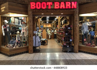 RIVER FALLS,WISCONSIN-JULY 06,2016: The Boot Barn sign and storefront.