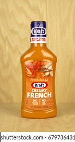 RIVER FALLS,WISCONSIN-JULY 14,2017: A bottle of Kraft brand creamy french dressing with a wood background.
