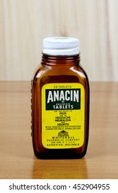 RIVER FALLS,WISCONSIN-JULY 15,2016: A vintage Anacin bottle with wood background. Anacin is a product of Whitehall Pharmacal Company.