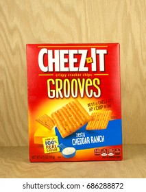 RIVER FALLS,WISCONSIN-JULY 29,2017: A box of Cheezit brand Grooves cracker chips with a wood background.