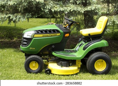 RIVER FALLS,WISCONSIN-JUNE 02,2015: A John Deere lawn tractor in River Falls,Wisconsin on June 02,2015. Deere and Company is Headquartered in Moline,Illinois.