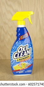 RIVER FALLS,WISCONSIN-MARCH 05,2017: A bottle of OxiClean brand laundry stain remover with a wood background.