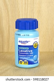 RIVER FALLS,WISCONSIN-MARCH 09,2017: A bottle of Equate brand stimulant laxative with a wood background