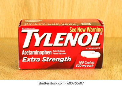 RIVER FALLS,WISCONSIN-MARCH 15,2017: A box of Tylenol acetaminophen caplets with a wood background.