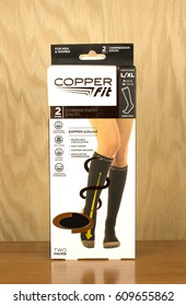 RIVER FALLS,WISCONSIN-MARCH 23,2017: A box of Copper Fit brand compression socks with a wood background.