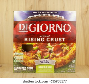 RIVER FALLS,WISCONSIN-MAY 08,2017: A DiGiorno brand rising crust pizza box with a wood background.