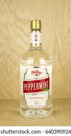 RIVER FALLS,WISCONSIN-MAY 12,2017: A bottle of Phillips brand Peppermint Schnapps with a wood background.