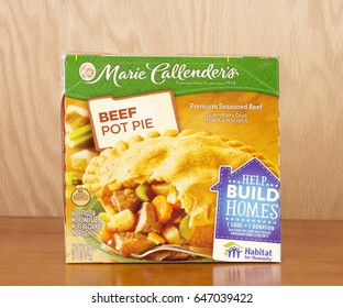 RIVER FALLS,WISCONSIN-MAY 25,2017: A Marie Callender's brand beef pot pie with a wood background.