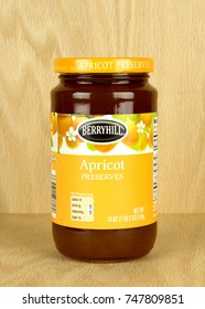 RIVER FALLS,WISCONSIN-NOVEMBER 03,2017: A jar of Berryhill brand Apricot preserves with a wood background.