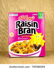 RIVER FALLS,WISCONSIN-NOVEMBER 06,2017: A box of Kellogg's brand raisin bran cereal with a wood background.