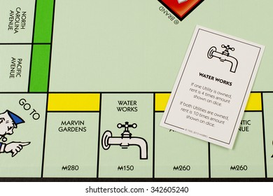 RIVER FALLS,WISCONSIN-NOVEMBER 11,2015: A Monopoly board featuring the Water Works card. Monopoly originated in the United States in Nineteen Hundred and Three.