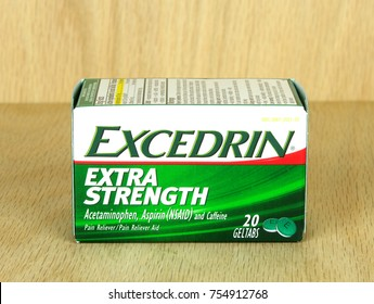 RIVER FALLS,WISCONSIN-NOVEMBER 14,2017: A box of Excedrin brand pain relief geltabs with a wood background.