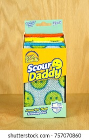 RIVER FALLS,WISCONSIN-NOVEMBER 17,2017: A box of Scour Daddy brand scrubbing pads with a wood background.