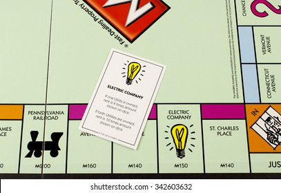 RIVER FALLS,WISCONSIN-NOVEMBER 21,2015: A closeup view of a Monopoly board featuring the Electric Company card.