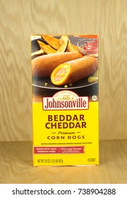 RIVER FALLS,WISCONSIN-OCTOBER 21,2017: A box of Johnsonville brand cheddar flavored corn dogs with a wood background.