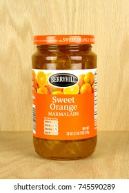 RIVER FALLS,WISCONSIN-OCTOBER 31,2017: A jar of Berryhill brand orange marmalade with a wood background.
