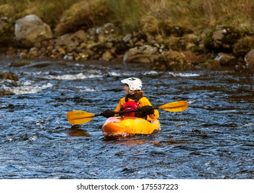 RIVER FINDHORN, NEAR FORRES, MORAY, SCOTLAND � 6 FEBRUARY: A member of a group of Kayaking enthusiasts on a journey down the River Findhorn near to Forres, Moray, Scotland on 6 February 2014.