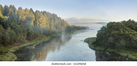 River. The first rays of dawn. Remains of fog