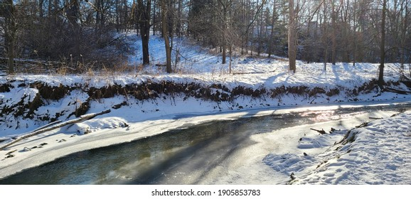 River flowing in a curve in snow