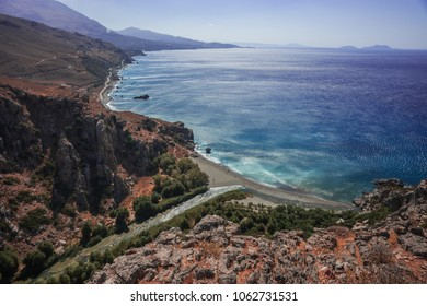 River flowing into sea at Preveli beach, Crete, Greece