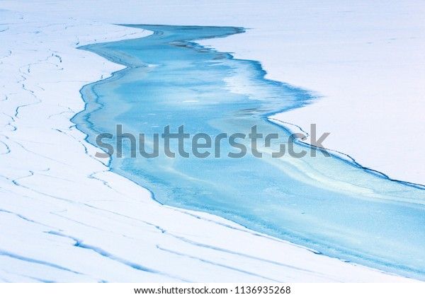 River flowing into the water dam. Winter season.
