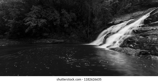 River flowing over wet rocks and the Debengeni Waterfall artistic conversion