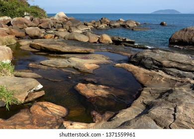 River flowing to the sea on a beach at Ilhabela island, Brazil
