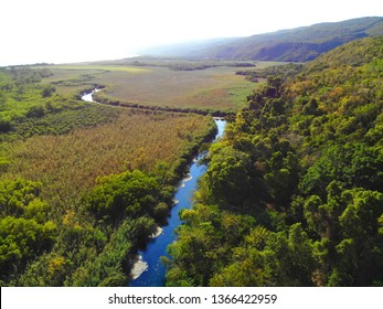 River flowing through land with mountains beyond - Clarendon, Jamaica
