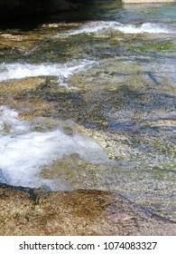 River flowing through rocky skin