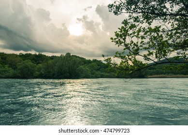 River flowing and vegetation with hills in the backgrounds