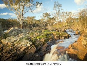 River flows through countryside on its way to Nigretta Falls in Western Victoria, Australia