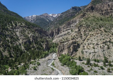 River flows through a deep valley in the Rocky Mountains near Yellowstone National Park in Wyoming.