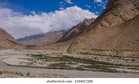 The river flows through the hills and mountain in the Askole village, K2 Base Camp, Pakistan