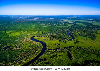 The river flows through the valley. Beautiful landscape. Aerial view. The bend of the river. Panorama. River landscape. Drone photography