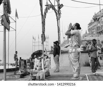River Ganges aarti performing by priest on the banks of Dashwamesh Ghat : Varanasi , Uttar Pradesh/India - April 2019