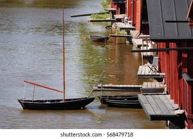 River Houses and A Boat