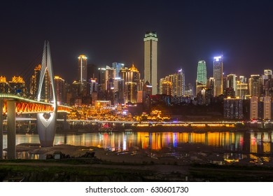 River And Illuminated Modern Buildings Against Sky at night in city of China.