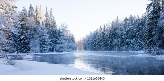 River ina Cold Winter landscape with snow and frost