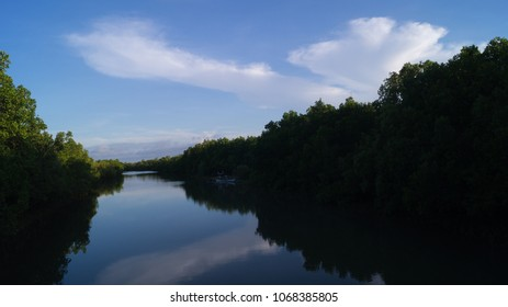 A river inside a mangrove park in Kalibo, Aklan, Philippines. Angled view of the scenery. Taken at five in the afternoon; during the month of April.