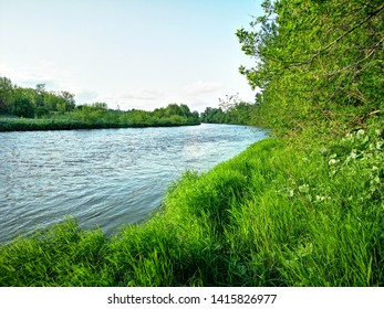 River Kadada in the Penza region.  Not deep but the riverbed is very winding and the banks are steep.  Beautiful landscape sky and water with grass in one photo.  Class
