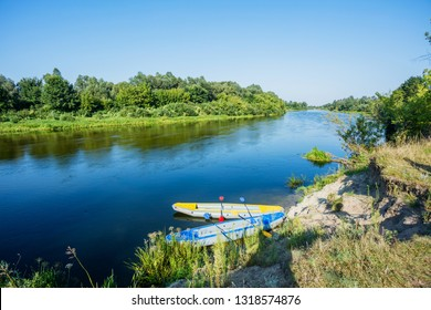 River Kayak Touring. Summer Recreations and Sport Photo Concept. Two Kayak on the river.