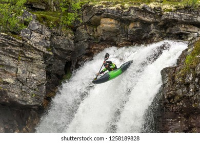 River kayaker in the river Ula in Rondane national park in Norway. 12.07.2015. Action, extreme sports, risk management, adrenaline, attack concepts.