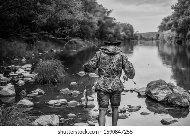 River lake lagoon pond. Trout farm. Fisherman alone stand in river water. Fisherman fishing equipment. Hobby sport activity. Man bearded fisherman. Fish farming pisciculture raising fish commercially.