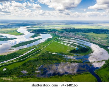River landscape, beautiful sky reflection in water. Vasyugan Swamp from aerial view. Siberia, Russia