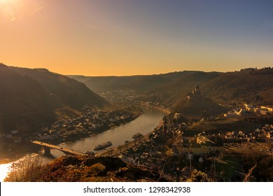 River landscape at the Moselle in Germany. In the morning light with village / place Cochem an old castle and a ship. taken from a view point