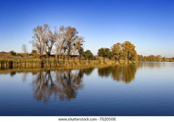 River landscape with sky reflection in water